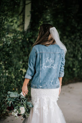 bride in jean jacket