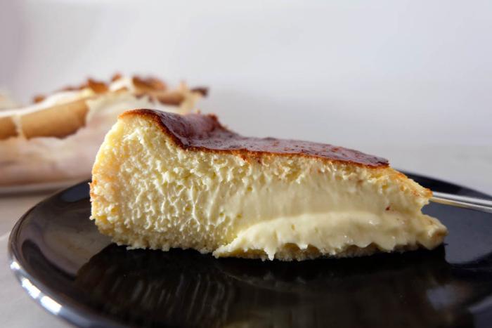 side view of custardy cheesecake slice