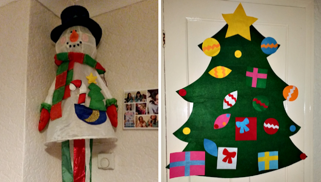 A hanging snowman and felt Christmas tree.
