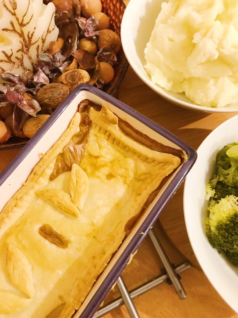 flatlay - chicken pie, mash, broccoli, autumnal bowl to the side with pot pourri and leaf shaped candle