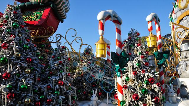 a display of snow-covered trees, candy canes, and Santa's sleigh