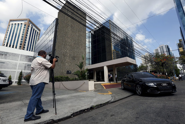 A cameraman is seen outside the Arango Orillac Building where the Mossack Fonseca law firm is situated at, in Panama City, April 4, 2016. REUTERS/Carlos Jasso