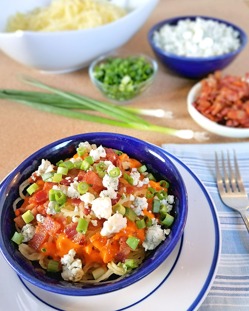 This Buffalo Blue Cheese Spaghetti Squash is a fun and healthy twist on chicken wings and blue cheese! Not only does it provide lots of veggies, it's grain-free, gluten-free, low-carb / low-glycemic, keto diet-friendly and Primal. It's a great way to satisfy your craving for chicken wings while sticking to your New Year's resolution to eat healthy!