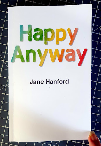 Happy anyway by Jane Hanford  book cover plain with rainbow coloured writing
