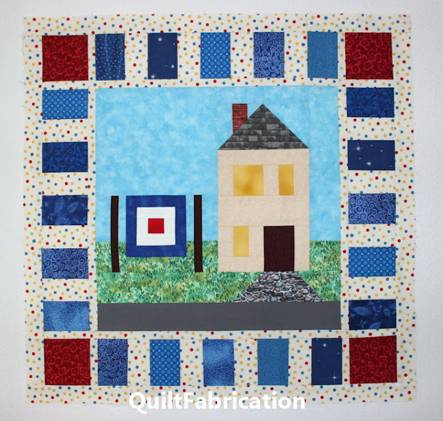 red and blue piano key border around a quilt block