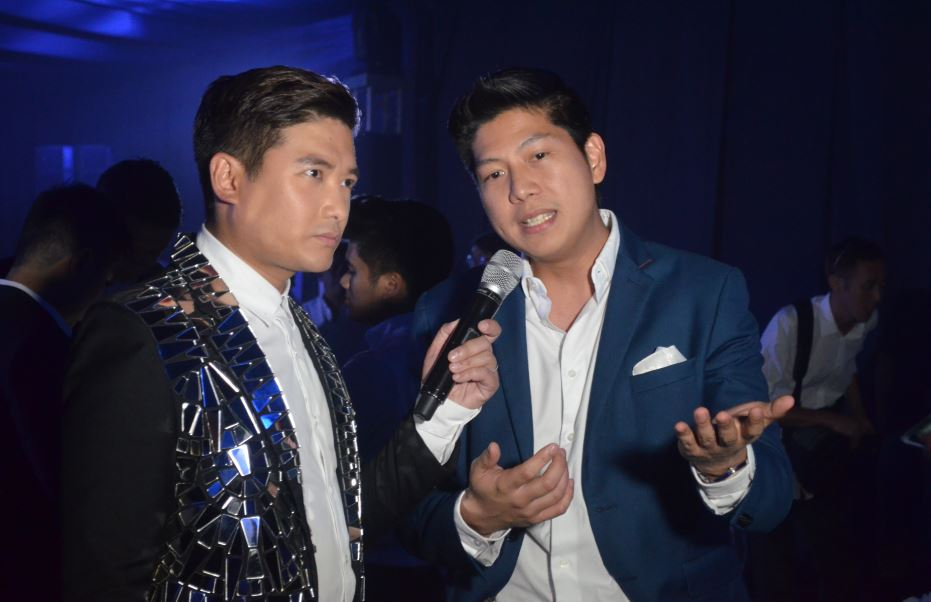 Host extraordinaire Tim Yap with Rhinn Piczon