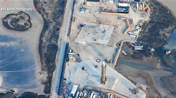 Starship SN10 on launch pad with SN9 landing pad and debris (Source: SpaceX)