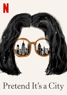 painted black hair and sunglasses with a skyline reflected in them
