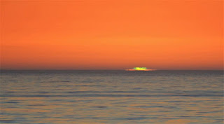 A Green Flash is a distinct green spot briefly visible above the upper rim of the Sun's disk; the green appearance usually lasts for no more than two seconds.