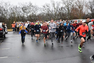 The pack is off and running in the 2019 Franklin 5K Turkey Trot