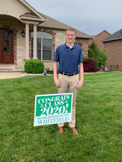 My friend Marla's son, Eric, standing in front of a Class of 2020 sign in the grassy front yard of his house.