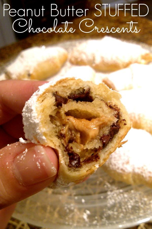 Peanut Butter Stuffed Chocolate Crescents! An easy sweet treat with crescent dough stuffed with peanut butter and mini chocolate chips sprinkled with powdered sugar.