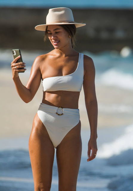 Montana Brown – Shows Her Beach Body In A White Swimsuit Out In Barbados