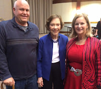 Bowden standing next to Former First Lady Rosalynn Carter and guests