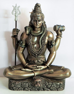 Modern day representation of Shiva holding the Trisula and Damaru