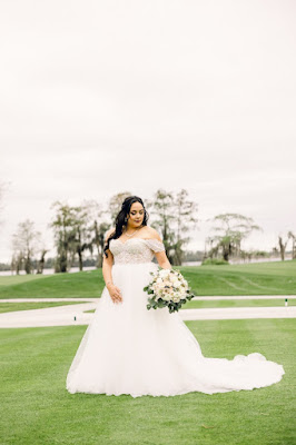bride in white dress with flowers