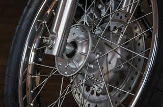 Motor bike wheels have spoke, but why not often seen on scooter wheels