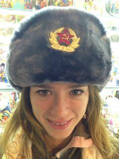 Camila admiring her hat