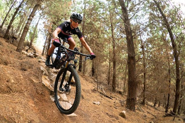 Xterra triathlete Jacqui Slack takes on a rock garden drop on an XC course.