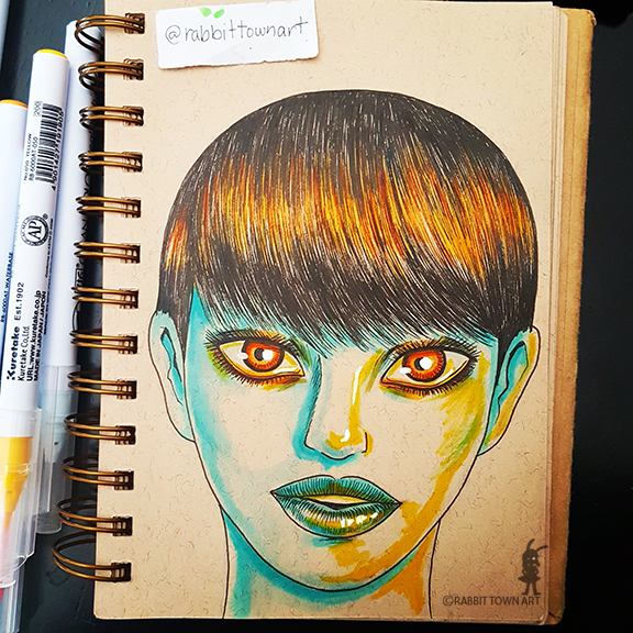 A facedoodle drawing by Marta Tesoro aka Rabbit Town Art.  It was done with zig and faber castell brush pens on a Daler and Rowney sketchbook