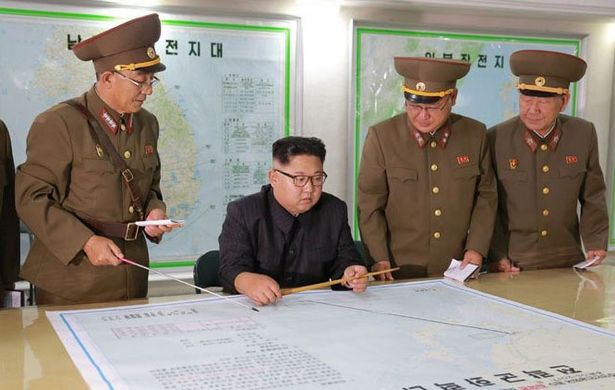 North Korea's leader holds fire on Guam missile launch