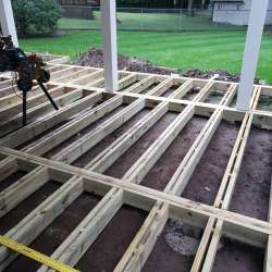 deck framing consists of a sister joist method for the concrete tiles