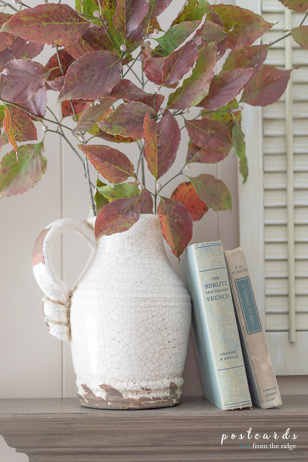 fall branches in a white crackled pitcher