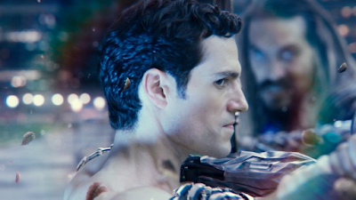A Whedon Cut shot of Superman from the side, grappling with Aquaman, his eye turned to look at the Flash.