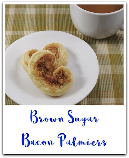 pastry filled with brown sugar and bacon on white plate with cup of coffee