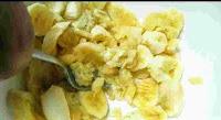 Mashing bananas with a fork for eggless banana cake recipe