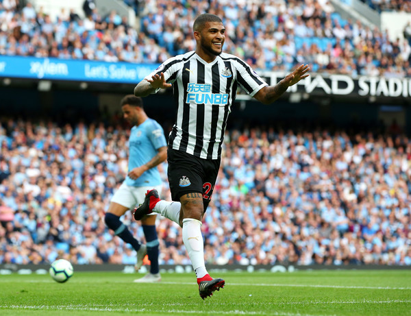 Deandre Yedlin of Newcastle United celebrates after scoring his team's first goal during the Premier League match between Manchester City and Newcastle United at Etihad Stadium on September 1, 2018 in Manchester, United Kingdom. (Aug. 31, 2018 - Source: Alex Livesey/Getty Images Europe)