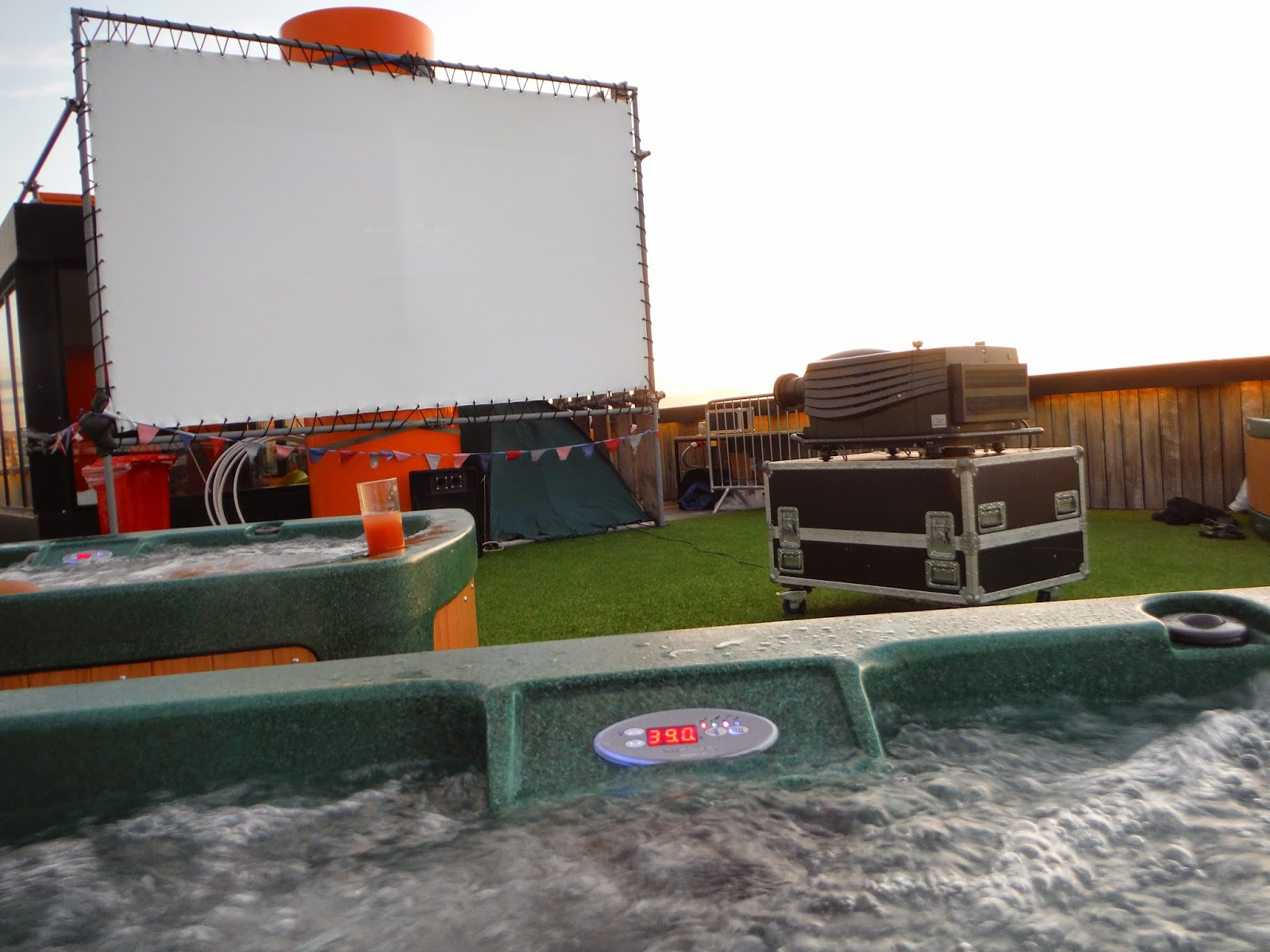 a view of the cinema screen from our hot tub