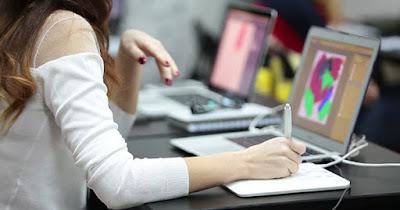 Woman illustrator working on tablet