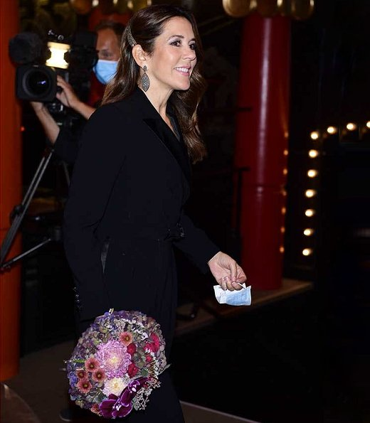 Crown Princess Mary wore a new tuxedo jumpsuit from Max Mara, and Hangisi jeweled pumps from Manolo Blahnik. Max Mara Dover tuxedo jumpsuit