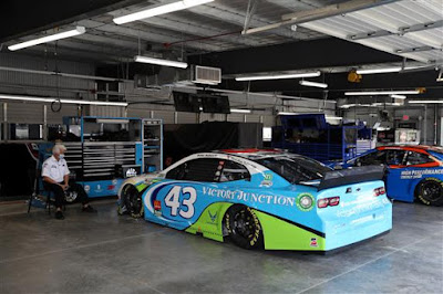 The #43 Victory Junction Chevrolet waits in the garage area (#NASCAR)