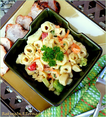 Vegetable Ranch Tortellini Salad, tortellini and mixed vegetables in a cool ranch dressing. Perfect side dish at any picnic. | Recipe developed by www.BakingInATornado.com | #recipe #pasta #dinner