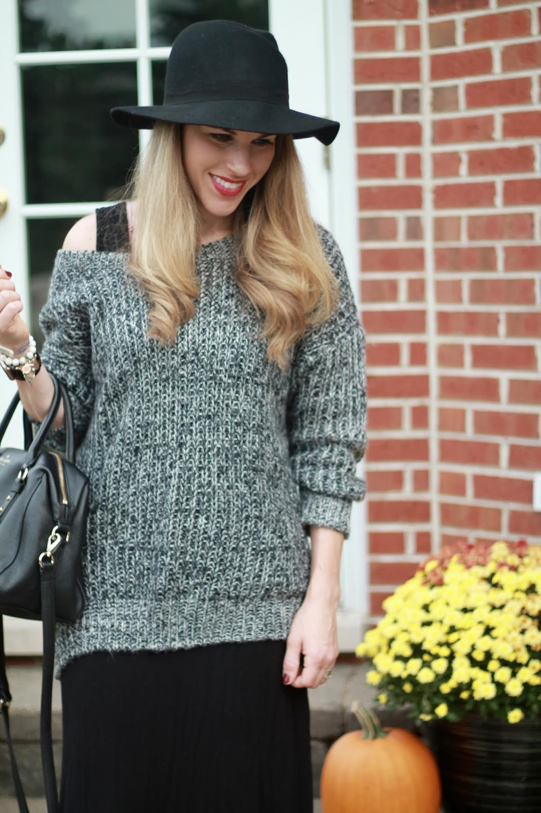 black marled sweater, black maxi dress, grey peep toe booties, black wool wide brim hat, black Kate Spade crossbody bag,