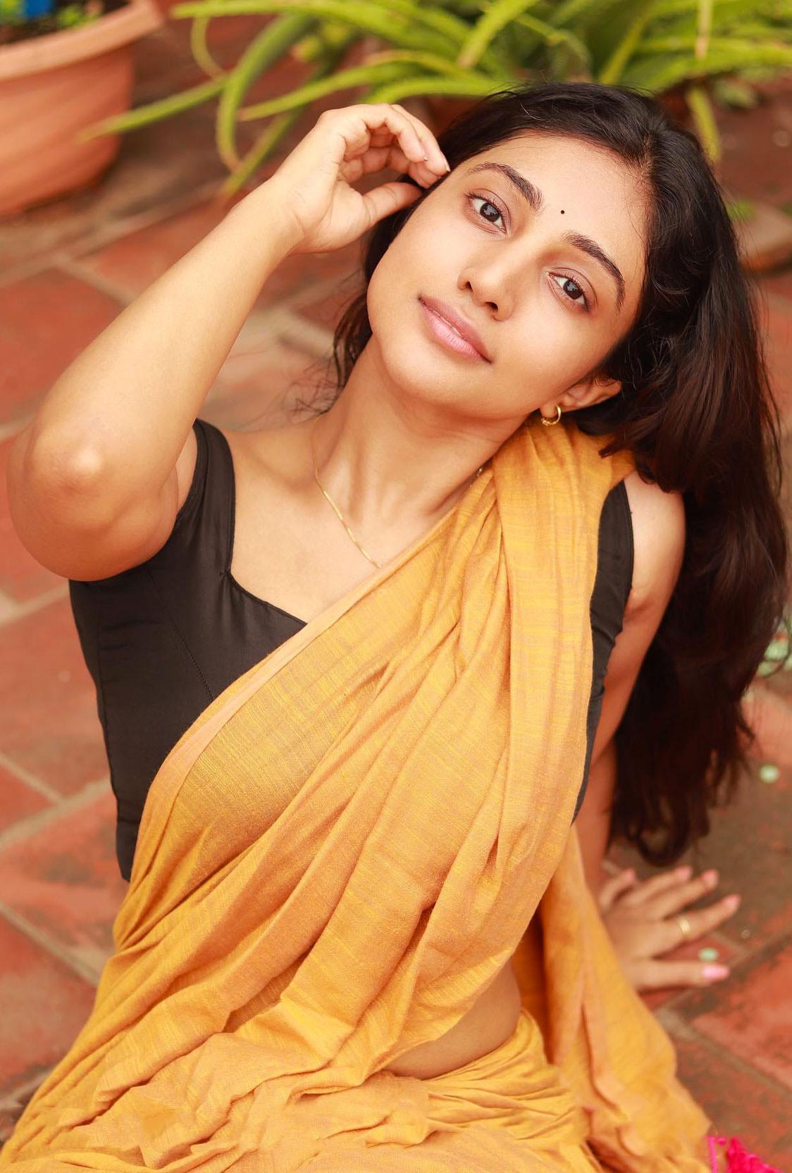 Bommu Lakshmi In orange cotton Saree Hot Photos