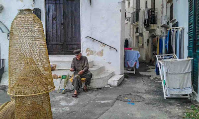 old craftsmen creators of fishing pots made of rush in Gallipoli village of Apulia region, southern Italy