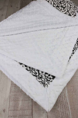 black and white minky blanket with a border.
