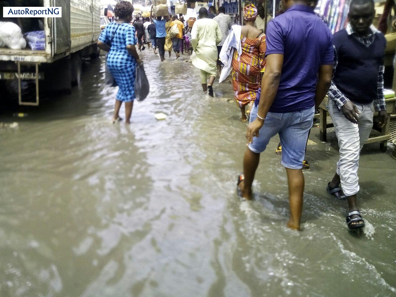 Flooded Jankara Market In Lagos Where Traders, Residents Wear Rain Boots To Work