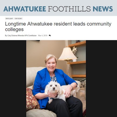 Snapshot of Ahwatukee Foothills News web story, featuring a photo of Dr. Thor in her living room with her pet dog