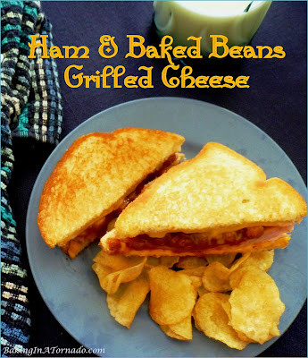 Ham and Baked Beans Grilled Cheese is a hearty sandwich. Ham and cheese meets grilled cheese with baked beans for added flavor. | Recipe developed by www.BakingInATornado.com | #recipe #sandwich
