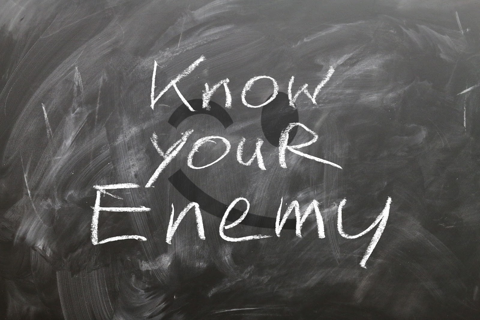 Chalkboard with words know your enemy to illustrate blog post about enemy POV movies