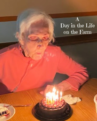 woman blowing out candles