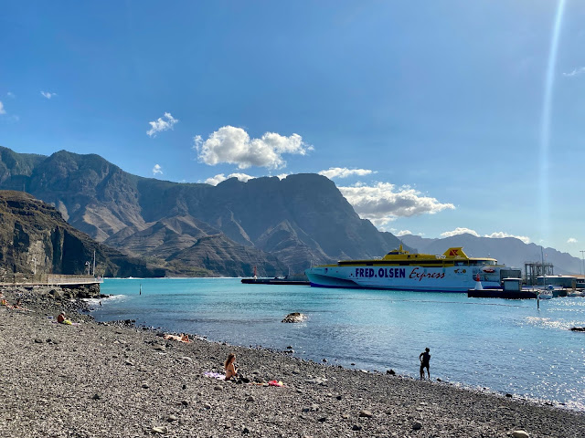 Beach and harbour with ferry boat at Agaete, Gran Canaria, Spain