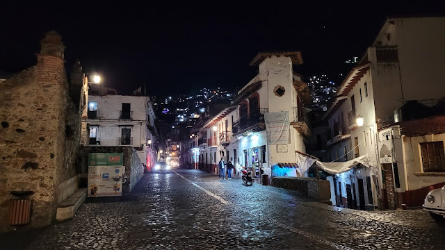 The cobblestone streets of Taxco at night