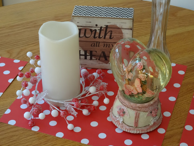 red and white candle wreath, polka dots and snowglobe for Valentine's Day