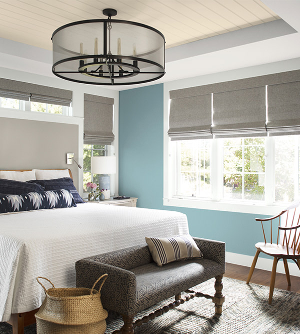 bedroom with bench, white quilt, walls painted with Benjamin Moore Aegean Teal