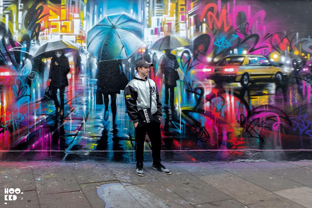 Posing in front of Dan Kitchener Mural in Shoreditch, London